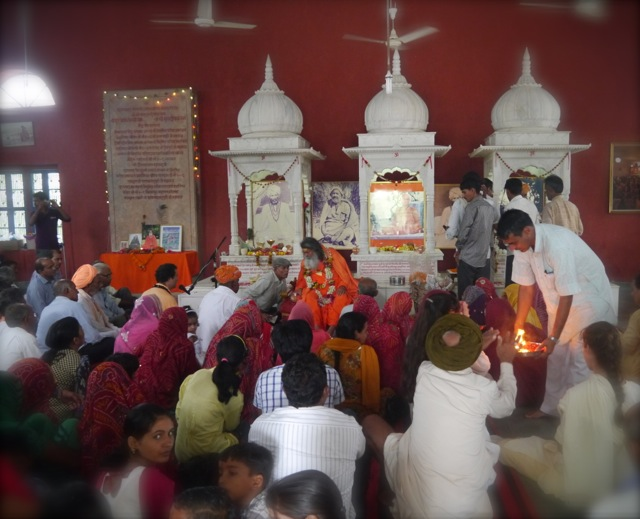 The light being offered to all after Pada Puja to Swamiji on His birthday morning