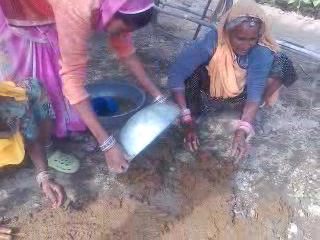 Making floor out of cow dung