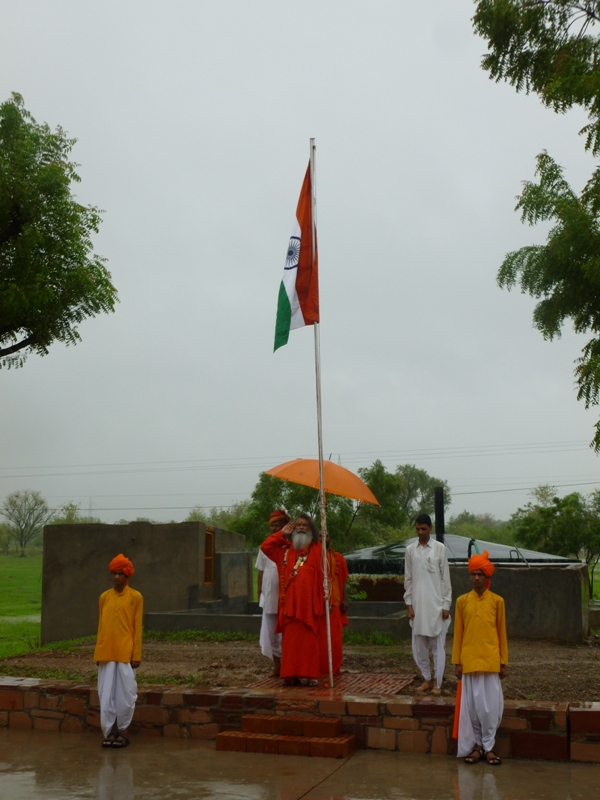 Swamiji hoisting Indian national flag